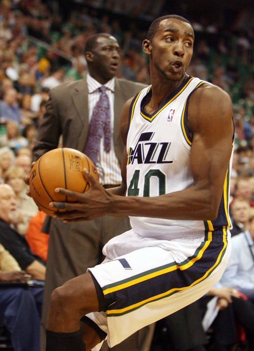 Steve Griffin  |  The Salt Lake Tribune  Utah's Jeremy Evans saves a ball during first half action in the Jazz versus Golden State preseason NBA basketball game at the EnergySolutions Arena in Salt Lake City, Utah Tuesday, October 8, 2013.