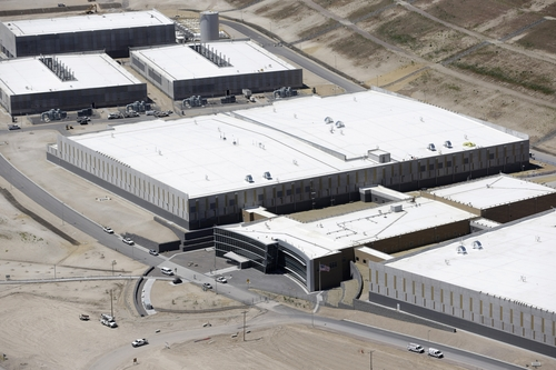 This June 6, 2013 photo shows an aerial view of the NSA's Utah Data Center in Bluffdale, Utah. The nation's new billion-dollar epicenter for fighting global cyberthreats sits just south of Salt Lake City, tucked away on a National Guard base at the foot of snow-capped mountains. The long, squat buildings span 1.5 million square feet, and are filled with super-powered computers designed to store massive amounts of information gathered secretly from phone calls and emails. (AP Photo/Rick Bowmer)