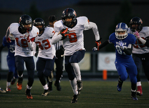 Scott Sommerdorf   |  The Salt Lake Tribune Brighton RB Isaiah Kaufusi runs back a fumble recovery for a TD to give Brighton a 14-7 lead. Bingham came back and held a 24-14 lead at the half over Brighton, Friday, October 4, 2013.