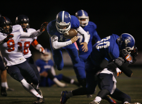 Scott Sommerdorf   |  The Salt Lake Tribune Bingham QB Kyle Gearig nearly loses control of the ball as he is upended on his way to set up a Bingham TD during first half play. Bingham held a 24-14 lead at the half over Brighton, Friday, October 4, 2013.