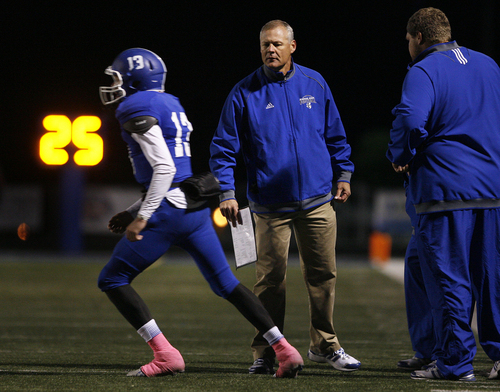 Scott Sommerdorf   |  The Salt Lake Tribune Bingham head coach Dave Peck sends QB Kyle Gearig in with a play during first half play. Bingham held a 24-14 lead at the half over Brighton, Friday, October 4, 2013.