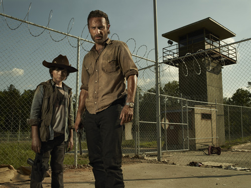 """Carl Grimes (Chandler Riggs) and Rick Grimes (Andrew Lincoln) in AMC's """"The Walking Dead."""" Courtesy Frank Ockenfels     AMC"""
