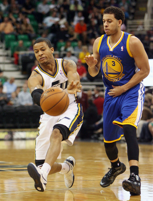 Steve Griffin  |  The Salt Lake Tribune  Utah's Trey Burke fires a bounce pass around Golden State's Seth Curry during first half action in the Jazz versus Golden State preseason NBA basketball game at the EnergySolutions Arena in Salt Lake City, Utah Tuesday, October 8, 2013.