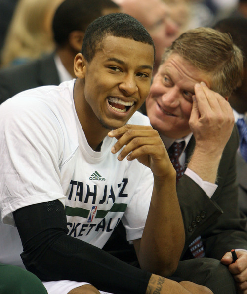 Steve Griffin  |  The Salt Lake Tribune  Utah's Trey Burke laughs from the bench during first half action in the Jazz versus Golden State preseason NBA basketball game at the EnergySolutions Arena in Salt Lake City, Utah Tuesday, October 8, 2013.