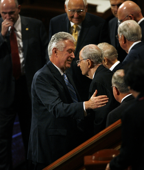 Scott Sommerdorf   |  The Salt Lake Tribune President Dieter F. Uchtdorf, left, visits with Elder Robert D. Hales of the Quorum of the Twelve Apostles as they leave the morning session of the 183rd LDS General Conference, Saturday, October 5, 2013.