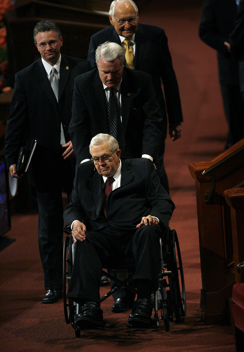 Scott Sommerdorf   |  The Salt Lake Tribune President Boyd K. Packer is helped as he leaves the afternoon session of the 183rd LDS General Conference in his wheelchair, Saturday, October 5, 2013.