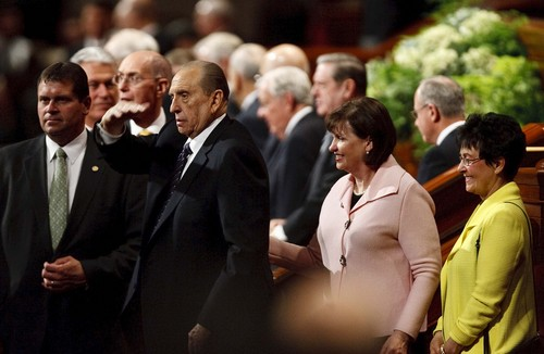 Leah Hogsten | The Salt Lake Tribune LDS President Thomas S. Monson waves goodbye to the audience as he and his daughter Ann Dibb leave the afternoon session of the LDS Church's 183rd Semiannual General Conference, Sunday, October 6, 2013.
