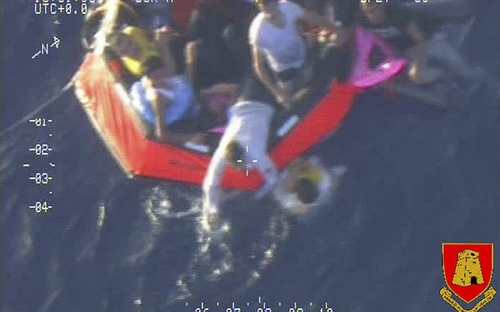In this photo released by the Maltese Army, migrants are aboard a life raft after a boat carrying an estimated 200 migrants capsized off the Sicilian island of Lampedusa Friday, Oct.11, 2013.  The capsizing occurred some 65 miles (105 kilometers) southeast of Lampedusa, but in waters where Malta has search and rescue responsibilities. Last week, a migrant boat carrying some 500 Eritreans capsized off Lampedusa, killing at least 339. Only 155 people survived. (AP Photo/Maltese Army HO)