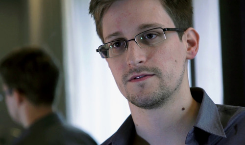 This photo provided by The Guardian Newspaper in London shows Edward Snowden, who worked as a contract employee at the National Security Agency, in Hong Kong, Sunday, June 9, 2013. According to a Department of Justice official on Friday, June 21, 2013, a criminal complaint has been filed against Snowden in the NSA surveillance case. (AP Photo/The Guardian)   MANDATORY CREDIT