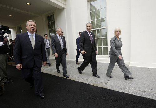 From left, Senate Majority Whip Richard Durbin of Ill., Senate Majority Leader Harry Reid of Nev., Sen. Charles Schumer, D-N.Y. and Senate Budget Committee Chair Sen. Patty Murray, D-Wash. leaving the West Wing of the White House in Washington, Thursday, Oct. 10, 2013, following a meeting with President Barack Obama regarding the budget. (AP Photo/Pablo Martinez Monsivais)