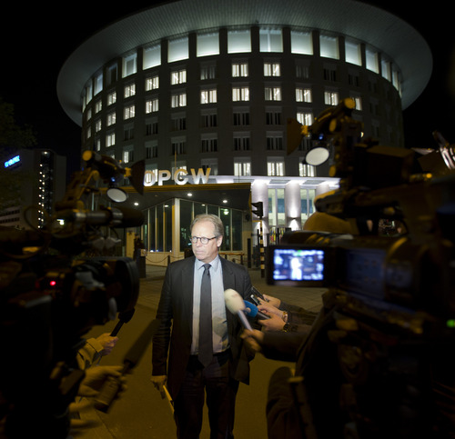 FILE - In this Friday Sept. 27, 2013 file photo spokesman Michael Luhan gives a brief statement outside the headquarters of the Organization for the Prohibition of Chemical Weapons, OPCW, in The Hague, Netherlands. The OPCW were awarded the Nobel Peace Prize on Friday, Oct. 11, 2013.  (AP Photo/Peter Dejong, File)