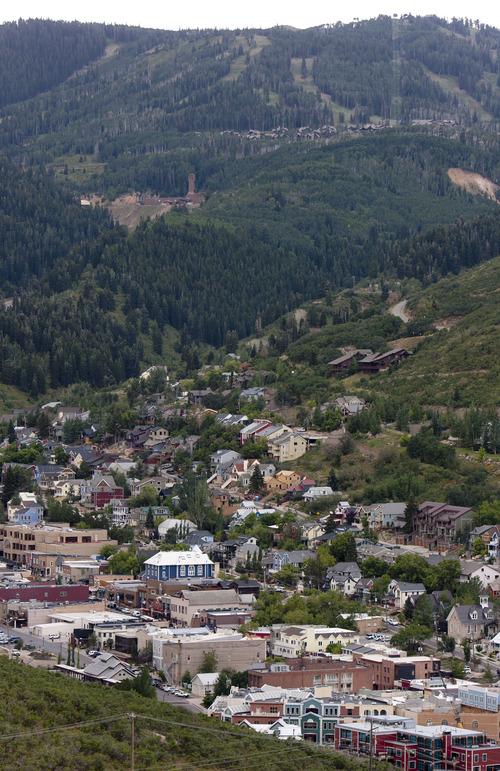 Steve Griffin | The Salt Lake Tribune  Ski runs loom in the background of Park City, Utah's Main Street Monday August 12, 2013.
