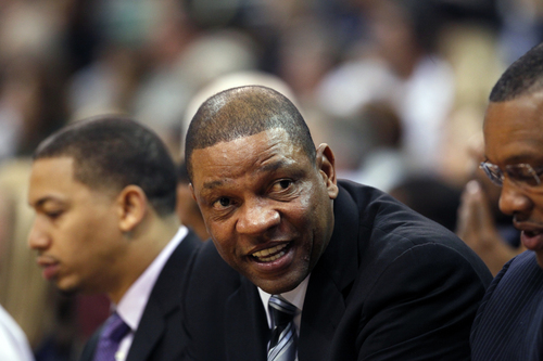 Los Angeles Clippers' head coach Doc Rivers sits on the sideline in the second half during an NBA preseason basketball game against the Utah Jazz Saturday, Oct. 12, 2013, in Salt Lake City.   The Clippers won 106-74. (AP Photo/Kim Raff)