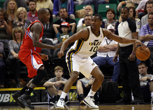 Utah Jazz's Alec Burks, right, looks to pass as Los Angeles Clippers' Jamal Crawford, left, in the first half during an NBA preseason basketball game Saturday, Oct. 12, 2013, in Salt Lake City.  (AP Photo/Kim Raff)