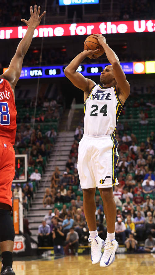Utah Jazz's Richard Jefferson takes a jump shot in the second half during an NBA preseason basketball game against the Los Angeles Clippers on Saturday, Oct. 12, 2013, in Salt Lake City.  The Clippers won 106-74. (AP Photo/Kim Raff)