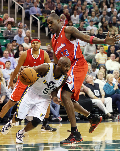 Utah Jazz's John Lucas III (5) dribbles past Los Angeles Clippers' Antawn Jamison (33) in the second half during an NBA preseason basketball game Saturday, Oct. 12, 2013, in Salt Lake City. The Clippers won 106-74. (AP Photo/Kim Raff)