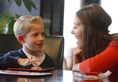 Leah Hogsten   The Salt Lake Tribune  Isaac Sintz, 7, works with his spelling and speech tutor Cassidy Ulrich, who is also his aunt, Tuesday, October 8, 2013.  Sintz is developmentally delayed due to a rare seizure disorder called Dravet Syndrome, and his mother April Sintz hopes he will learn to read one day. Sintz and a group of Mormon, Utah moms are pushing to legalize medical marijuana for children with seizure disorders. She is hoping for access to a high-CBD/low-THC cannabis extract that is not smoked and does not cause a high, but does hold great promise for controlling seizures and improving children's lives.