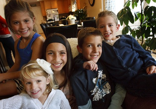 Leah Hogsten | The Salt Lake Tribune Isaac Sintz, 7, (far right) is championed and mentored by his cousins Josh Hair, (right) 10, Lexi, 7, (far left) and his older sister Demi holding his younger sister Ellie, 4, Tuesday, October 8, 2013.  Sintz is developmentally delayed due to a rare seizure disorder called Dravet Syndrome, and his mother April Sintz hopes he will learn to read one day. Sintz and a group of Mormon, Utah moms are pushing to legalize medical marijuana for children with seizure disorders. She is hoping for access to a high-CBD/low-THC cannabis extract that is not smoked and does not cause a high, but does hold great promise for controlling seizures and improving childrenís lives.