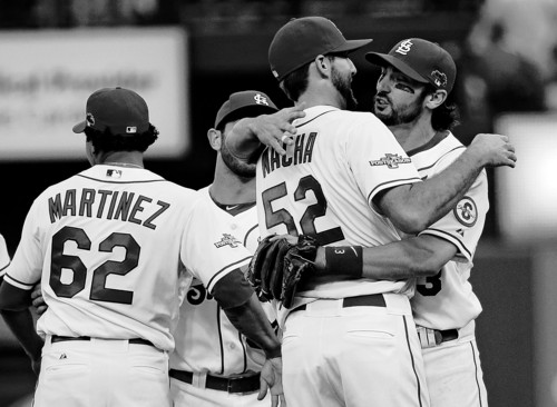 St. Louis Cardinals' Matt Carpenter hugs Michael Wacha (52) after Game 2 of the National League baseball championship series against the Los Angeles Dodgers Saturday, Oct. 12, 2013, in St. Louis. Cardinals won 1-0 to take a 2-0 lead in the series. (AP Photo/David J. Phillip)