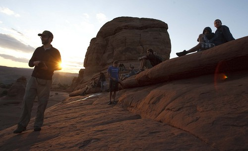 Leah Hogsten | The Salt Lake Tribune Visitors mingled around Delicate Arch to watch the sunset in the newly reopened Arches National Park , Friday, October 11, 2014.Thanks to a $1.7 million payment from Utah taxpayers, the national parks of southern Utah are being exempted from the federal government shutdown just in time for a traditionally busy fall weekend.