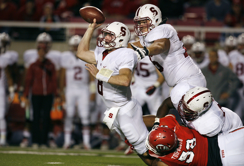 Scott Sommerdorf   |  The Salt Lake Tribune Stanford Cardinal quarterback Kevin Hogan (8) gets off a pass just as he is about to be sacked by Utah Utes defensive tackle LT Tuipulotu (58) during fourth quarter play. Utah upset #5 Stanford 27-21, Saturday, October 12, 2013.