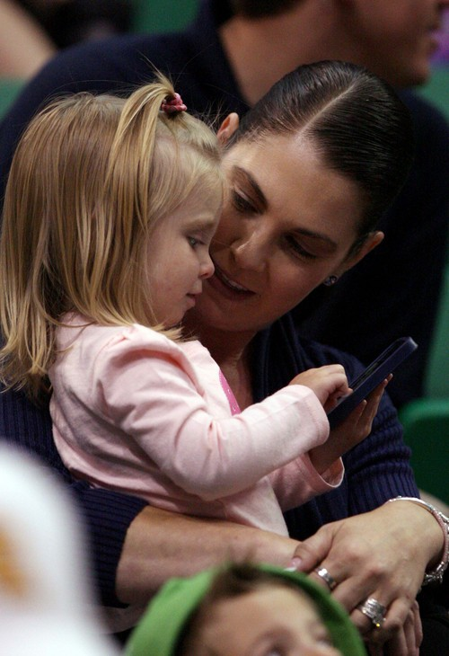 Leah Hogsten | The Salt Lake Tribune Gina Zanik, wife of Utah Jazz assistant general manager Justin Zanik entertains her daughter Lucy, 2, while watching the team at EnergySolutions Arena during the annual scrimmage Saturday, October 5, 2013. The Zanik's daugher Ava, 6, had four brain surgeries this summer to drain a burst cyst on her brain.