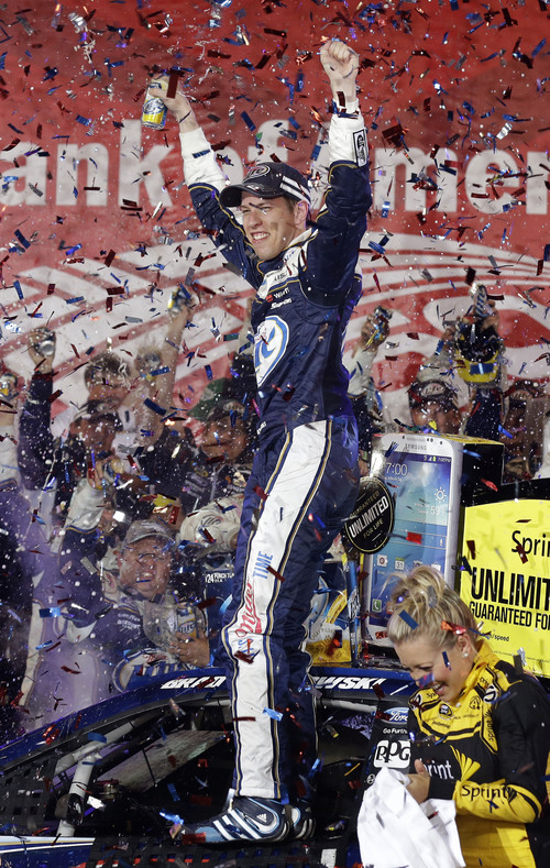 Brad Keselowski celebrates in Victory Lane after winning the NASCAR Sprint Cup Series auto race at Charlotte Motor Speedway in Concord, N.C., Saturday, Oct. 12, 2013. (AP Photo/Gerry Broome)