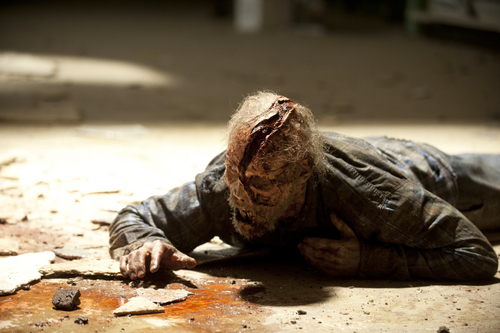 """This image released by AMC shows a walker in a scene from the season four premiere of """"The Walking Dead,"""" airing Oct. 13 at 9 p.m. EST. (AP Photo/AMC, Gene Page)"""