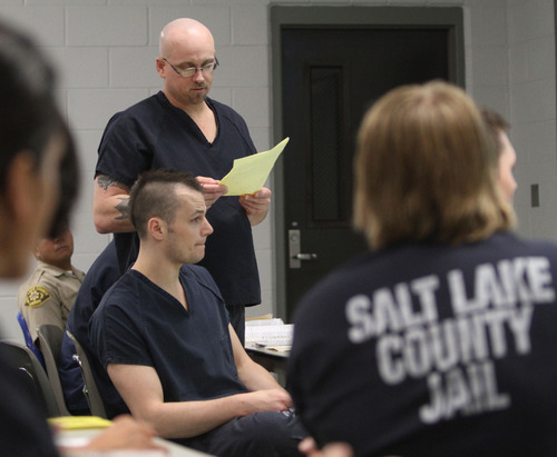 Rick Egan  | The Salt Lake Tribune   John P. Stickney reads a poem during the Graveyard GOGI (Getting Out by Going In) class at Salt Lake County's Oxbow Jail. Stickney was released from the jail in September. Monday, August 26, 2013.