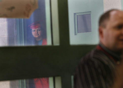 Scott Sommerdorf   |  The Salt Lake Tribune  Cherish Wakefield looks through a window at the Wasatch County Jail as she waits in a hallway with other female inmates who participated in a 12-week GOGI program for a graduation ceremony to begin. Thursday, August 22, 2013.