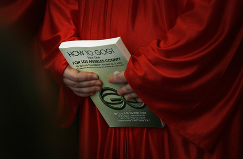 Scott Sommerdorf   |  The Salt Lake Tribune  A female inmate holds a GOGI book at a graduation ceremony at the Wasatch County Jail, Thursday, August 22, 2013.