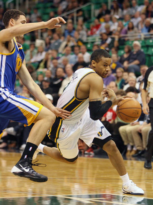 Steve Griffin  |  The Salt Lake Tribune  Utah's Trey Burke drives around Golden State's Klay Thompson during first half action in the Jazz versus Golden State preseason NBA basketball game at the EnergySolutions Arena in Salt Lake City, Utah Tuesday, October 8, 2013.