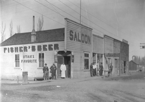 "During the days when Sandy was a rough western mining town, it's been said 17 or so saloons were strung out along Main Street and frequented by residents, travelers, and miners. At one time, Hans Nelson Bjork and Ole Nelson's ""Swede Saloon"" was located here. In 1916 and in this site, the spontaneously named Damifino Saloon greeted the public. Then in 1930, Y. Martin Anderson, a meat cutter for 37 years, used the site to build his meat business. (115 Main Street) 115 East 8720 South photo facing north and east Sandy Museum Foundation"