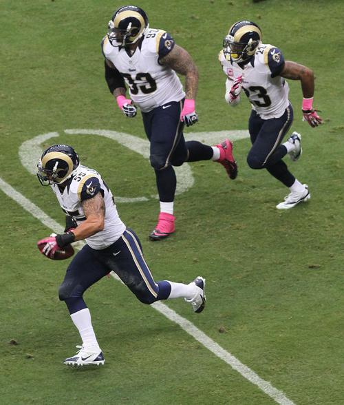 St. Louis Rams linebacker James Laurinaitis runs down field after recovering a fumble during an NFL football game Sunday, Oct. 13, 2013, in Houston. St. Louis defeated Houston 38-13. (AP Photo/ The Courier, Jason Fochtman)
