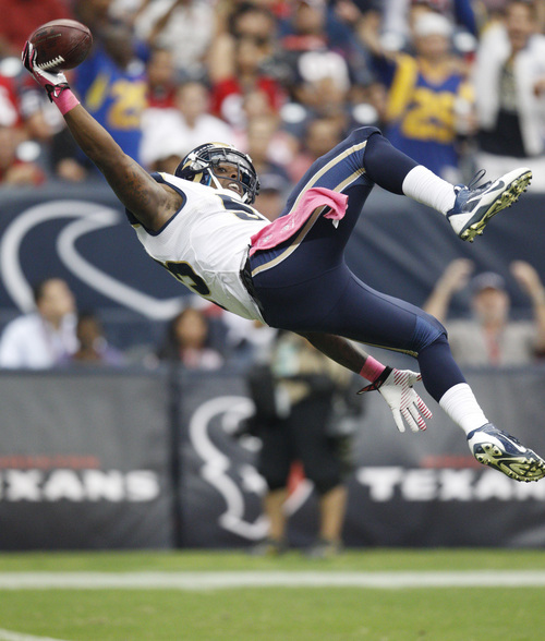 St. Louis Rams linebacker Daren Bates dives into the end zone for a touchdown after recovering a fumble by Houston Texans' Keshawn Martin on a kickoff return during the third quarter of an NFL football game Sunday, Oct. 13, 2013 in Houston. The Rams defeated the Texans 38-13. (AP Photo/The Galveston County Daily News, Kevin M. Cox) MANDATORY CREDIT
