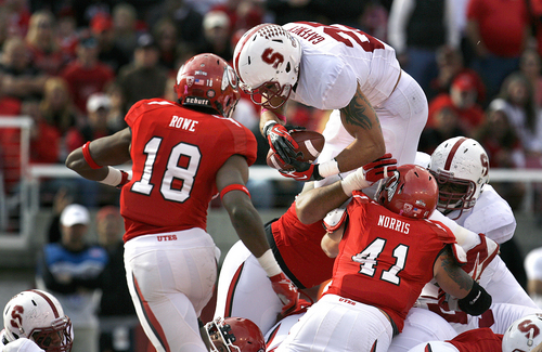 Scott Sommerdorf   |  The Salt Lake Tribune Stanford Cardinal running back Tyler Gaffney (25) leaps over the goal line for the first TD of the game to take a 7-0 Stanford lead. Utah led Stanford 21-14 at the half, Saturday, October 12, 2013.