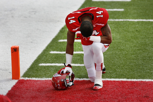 Scott Sommerdorf   |  The Salt Lake Tribune Utah WR Brian Allen (14) prays prior to kickoff versus Stanford. Utah upset #5 Stanford 27-21, Saturday, October 12, 2013.