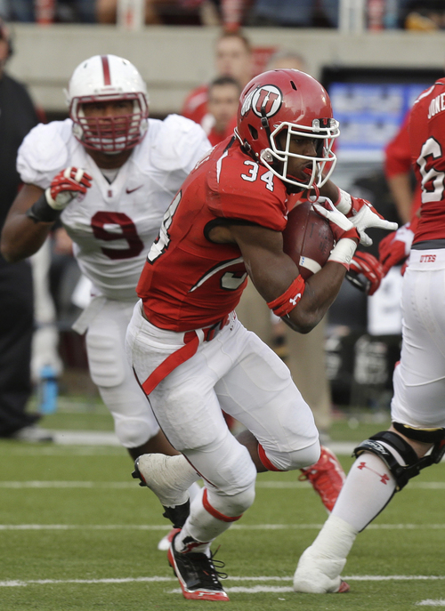 Utah running back Bubba Poole (34) carries the ball as Stanford linebacker James Vaughters (9) defends during first half of an NCAA college football game on Saturday, Oct. 12, 2013, in Salt Lake City. Utah won 27-21. (AP Photo/Rick Bowmer)