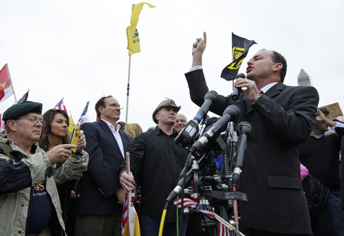 Sen. Mike Lee, R-Utah, speaks at a rally near the World War II Memorial in Washington Sunday, Oct. 13, 2013. The rally was organized to protest the closure of the Memorial and access to it by World War II veterans who traveled there on Honor Flight visits. The memorial has been closed due to the partial federal government shutdown. (AP Photo/Alex Brandon)