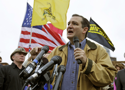 Tea Party Sen. Ted Cruz, R-Texas, speaks at a rally at the World War II Memorial in Washington Sunday, Oct. 13, 2013. Leaders in the U.S. Senate have taken the helm in the search for a deal to end the partial government shutdown and avert a federal default. The rally was organized to protest the closure of the Memorial, subsequent to the shutdown, and lack of access to it by World War II veterans, who traveled there on Honor Flight visits. (AP Photo/Alex Brandon)