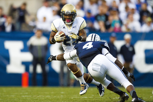 Georgia Tech Robert Godhigh (25) runs the ball around Brigham Young defensive back Robertson Daniel (4) during an NCAA college football game Saturday, Oct. 12, 2013 in Provo, Utah. (AP Photo/The Daily Herald, Alex Goodlett)