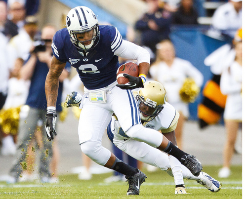 Brigham Young wide receiver Cody Hoffman (2) dodges a tackle by Georgia Tech player DJ White (28) during an NCAA college football game Saturday, Oct. 12, 2013 at  in Provo, Utah. (AP Photo/The Daily Herald, Alex Goodlett)