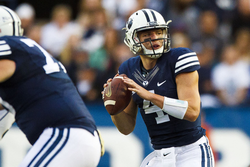 Brigham Young quarterback Taysom Hill (4) looks to pass during an NCAA college football game Saturday, Oct. 12, 2013  in Provo, Utah. (AP Photo/The Daily Herald, Alex Goodlett)