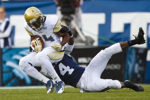 Georgia Tech wide receiver Michael Summers (84) is tackled by Brigham Young defensive back Robertson Daniel (4) during an NCAA college football game Saturday, Oct. 12, 2013 at  in Provo, Utah. (AP Photo/The Daily Herald, Alex Goodlett)