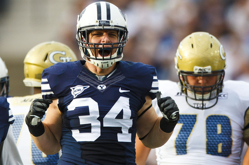 Brigham Young linebacker Austen Jorgensen (34) celebrates after a play during an NCAA college football game Saturday, Oct. 12, 2013 at  in Provo, Utah. (AP Photo/The Daily Herald, Alex Goodlett)