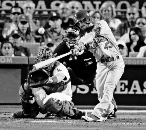 Chris Carlson | The Associated Press St. Louis Cardinals' Shane Robinson hits a home run during the seventh inning of Game 4 of the National League baseball championship series against the Los Angeles Dodgers Tuesday, Oct. 15, 2013, in Los Angeles. (AP Photo/Chris Carlson)