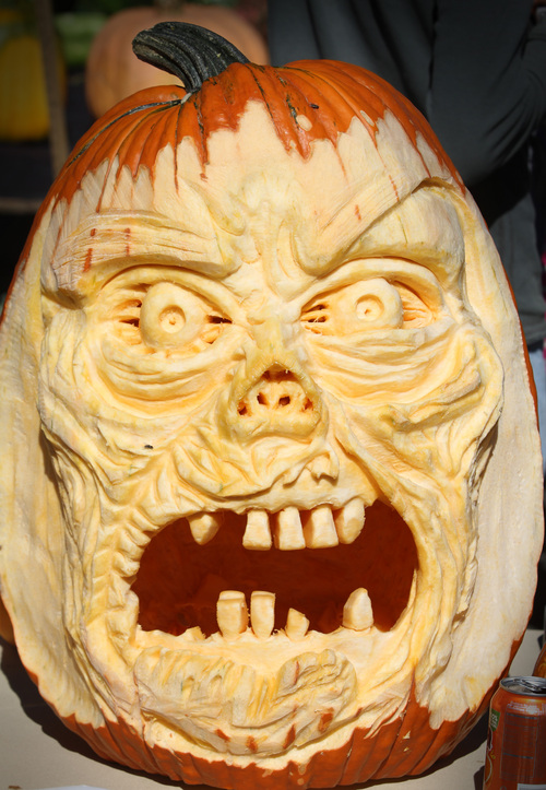 Rick Egan  |  The Salt Lake Tribune Carved pumpkins on display at the Utah Giant Pumpkins annual pumpkin weigh-off at Thanksgiving Point on Saturday.