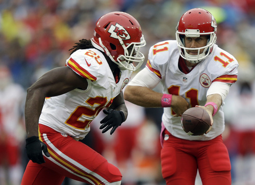 Kansas City Chiefs quarterback Alex Smith (11) hands off to running back Jamaal Charles (25) in the second quarter of an NFL football game against the Tennessee Titans, Sunday, Oct. 6, 2013, in Nashville, Tenn. Charles led the Chiefs in rushing with 108 yards and one touchdown. (AP Photo/Wade Payne)