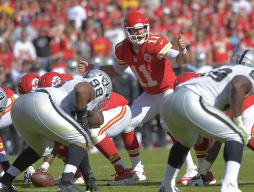Kansas City Chiefs quarterback Alex Smith (11) call out directions to his team during their NFL football game against the Oakland Raiders in Kansas City, Mo., Sunday, Oct. 13, 2013. (AP Photo/Reed Hoffmann)