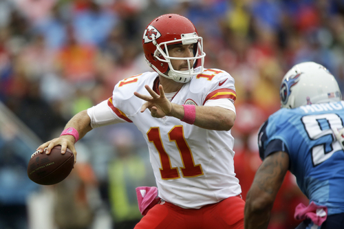 Kansas City Chiefs quarterback Alex Smith passes as Tennessee Titans defensive end Derrick Morgan (91) rushes in the second quarter of an NFL football game on Sunday, Oct. 6, 2013, in Nashville, Tenn. (AP Photo/Wade Payne)